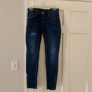 Dark wash skinny jeans with slight rips